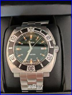 NWT DOXA AQUAMAN WATCH and SIGNED Book by Dr. Peter Millar and Clive CUSSLER